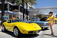 Great American Beach Party 2012 vintage cars, girl in yellow bikini