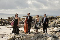 Galway Ensemble in Residence - ConTempo.On the way to the islands - - with Haydn & Mendelssohn!..The Galway Ensemble in Residence - Con Tempo, set off this morning for  Inis Oírr where they will begin their first ever County Galway tour, bringing the music of Haydn and Mendelssohn to the people of Galway in celebration of both composers whose bi-centenaries occurred this year. ..Pictured enroute to the Ferry at Rossaveal are:  Andreea Banciu, viola and Adrian Mantu, 'cello,   Ingrid Nicola, violin, Bogdan Sofei, violin..The tour will continue over the weekend in various venues throughout the county before the grand finale in St. Nicholas Church with classical guitarist John Feeley on Sunday night. Photo : Andrew Downes. Photo issued with compliments, no reproduction fee...Tickets for all concerts will be available at the door. Check your local venue for more information or log on to www.galwayensemble.ie.