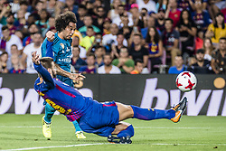 August 13, 2017 - Barcelona, Catalonia, Spain - Real Madrid defender MARCELO competes with FC Barcelona defender PIQUE for the ball during the Spanish Super Cup Final 1st leg between FC Barcelona and Real Madrid at the Camp Nou stadium in Barcelona (Credit Image: © Matthias Oesterle via ZUMA Wire)