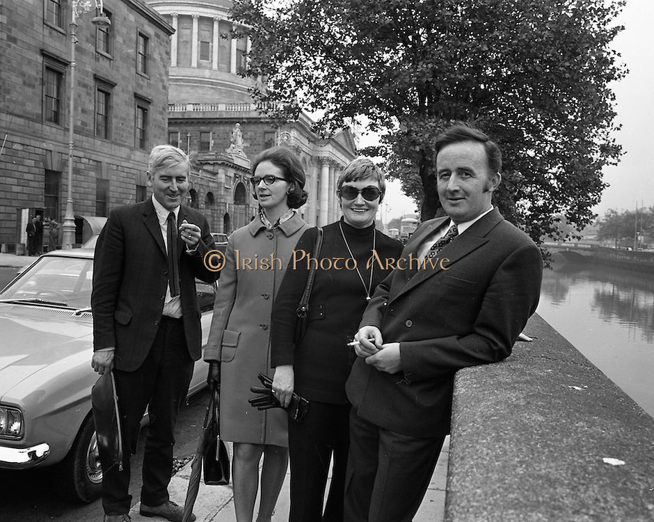 22/9/1970<br /> 9/22/1970<br /> 22 September 1970<br /> <br /> Capt. James Kelly (right) one of the accused with his wife (3rd form the left Mrs Theresa Connly, sister of Capt. Kelly and Mr. Tom Macintyre at the Four Courts before the trial