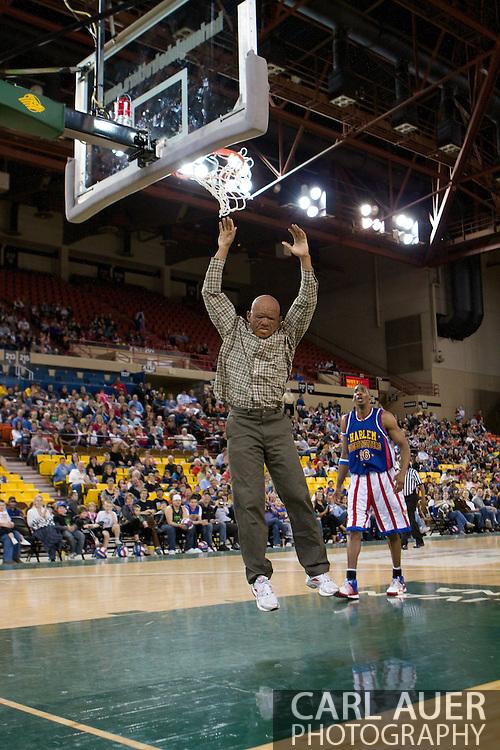 April 30th, 2010 - Anchorage, Alaska:  Globetrotter Moo Moo Evans, dressed up as an elderly former Globetrotter dunks for the fans.