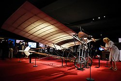 "© Licensed to London News Pictures. 23/05/2017. London, UK.   A visitor views a replica Santos-Dumont 20 aeroplane at the press preview of ""Cartier in Motion"", an exhibition on Cartier,  co-curated by celebrated architect Lord Norman Foster and Design Museum director Deyan Sudjic, at the Design Museum in London.  The exhibition runs from 25 May to 28 July 2017. Photo credit : Stephen Chung/LNP"