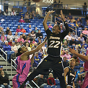 Towson Tigers Guard Tanisha McTiller (22) drives to the basket in the second half of a NCAA regular season Colonial Athletic Association conference game between Delaware and The Towson Tigers Sunday, Feb 16, 2014 at The Bob Carpenter Sports Convocation Center in Newark Delaware.
