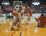 """Mississippi guard Trevor Gaskins (23) drives as Georgia's Jeremy Price (50) defends at the C.M. """"Tad"""" Smith Coliseum in Oxford, Miss. on Saturday, January 15, 2011.  (AP Photo/Oxford Eagle, Bruce Newman)"""