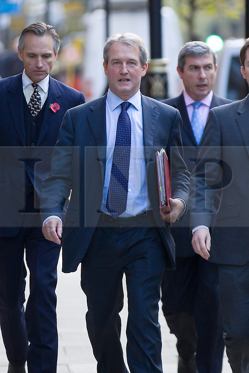 © Licensed to London News Pictures. 07/11/2012. London, UK. Owen Paterson (C), the Secretary of State for Environment is seen arriving at a tree health summit to discuss the ash dieback disease outbreak in London today (07/11/12). The meeting, chaired by Mr Paterson, will bring together scientists non-governmental agencies and stakeholders to discuss tree health and ways to tackling the present British outbreak of ash dieback disease. Photo credit: Matt Cetti-Roberts/LNP