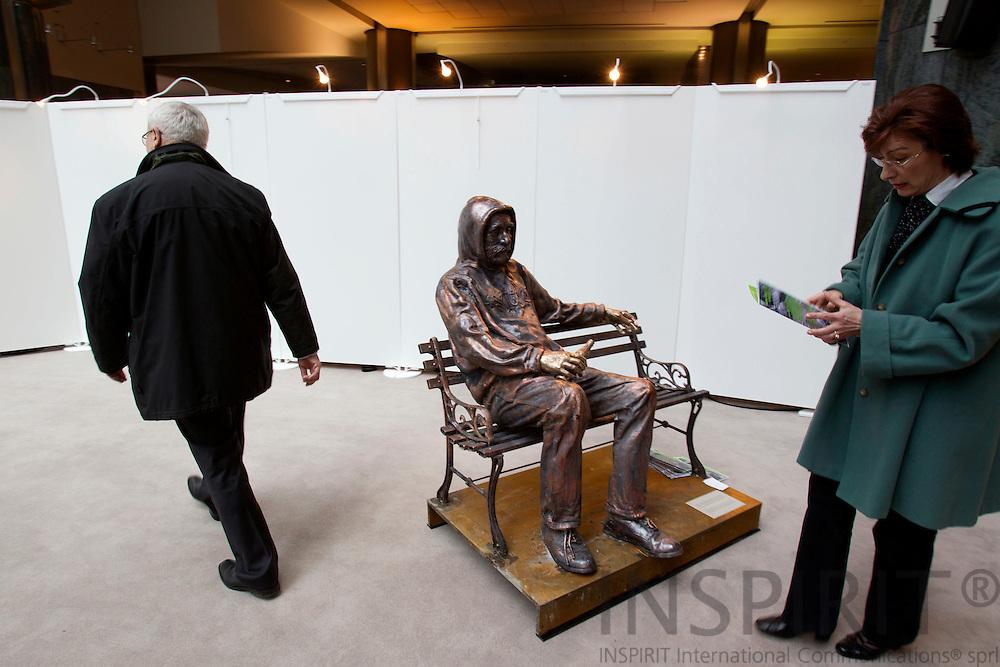 BRUSSELS - BELGIUM - 14 APRIL 2010 -- Den danske kunstner Jens Galschiøt udstiller bronze skulpturer af hjemløse i EU-Parlamentet i Bruxelles. Det sker under navnet Stop Hjemløshed!, som er arrangeret af den danske NGO Projekt Udenfor. De har hyret Jens Galschiøt til at lave i alt 13 skulpturer af hjemløse, der repræsenterer typiske historier fra hjemløse i Europa. Photo: Erik Luntang/INSPIRIT Photo..The artist and activist Jens Galschiøt (DK) joins the homeless organizations to put focus on the great number of homeless in Europe by visiting the European Parliament 12th to 16th April..Galschiøt has created 13 big bronze sculptures of homeless people, all in natural size. These very heavy sculptures are by now on their way to the European Parliament to act as the start signal for a debate in all member countries about the conditions under which the homeless have to cope. Galschiøt has created 13 big bronze sculptures of homeless people, all in natural size. These very heavy sculptures are by now on their way to the European Parliament to act as the start signal for a debate in all member countries about the conditions under which the homeless have to cope...