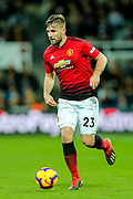 Luke Shaw (#23) of Manchester United on the ball during the Premier League match between Newcastle United and Manchester United at St. James's Park, Newcastle, England on 2 January 2019.
