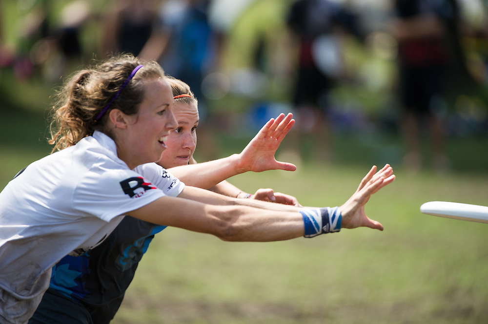 Ellie Hand (Traffic #8) and a QUB player bid for the disc during day 5 of the 2014 World Ultimate Club Championship in Lecco, Italy. Aug 6, 2014. ©2014 Jeff Bell Photo. All Rights Reserved.