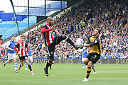 Sheffield United striker Leon Clarke (9) battles with Sheffield Wednesday goalkeeper Keiren Westwood (1)     during the EFL Sky Bet Championship match between Sheffield Wednesday and Sheffield Utd at Hillsborough, Sheffield, England on 24 September 2017. Photo by Phil Duncan.