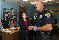 Police Officer Megan DeNute shakes hands with Chief Chris Adams after the swearing in ceremony at Laconia City Hall Thursday afternoon.  (Karen Bobotas/for the Laconia Daily Sun)