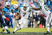 NASHVILLE, TN - SEPTEMBER 29:  Geno Smith #7 of the New York Jets tries to avoid the rush from Kamerion Wimbley #95 and Zach Brown #55 of the Tennessee Titans at LP Field on September 29, 2013 in Nashville, Tennessee.  The Titans defeated the Jets 38-13.  (Photo by Wesley Hitt/Getty Images) *** Local Caption *** Geno Smith; Kamerion Wimbley; Zach Brown