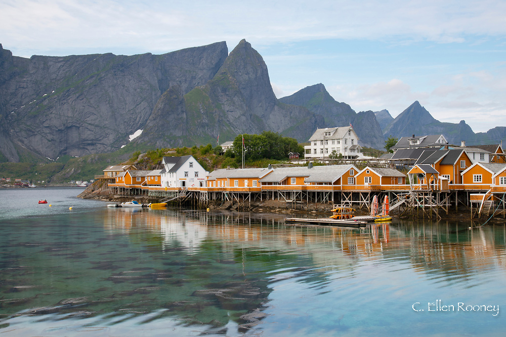 Rorbu, traditional fishing huts now used for tourist accommodation in the fishing village of Reine on Reine Fjord,  Moskensoya, Lofoten Islands, Norway