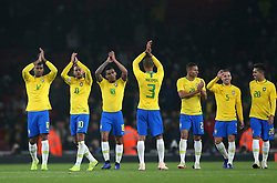 Brazil's Neymar (centre) applauds fans after the final whistle during the International Friendly match at the Emirates Stadium, London.