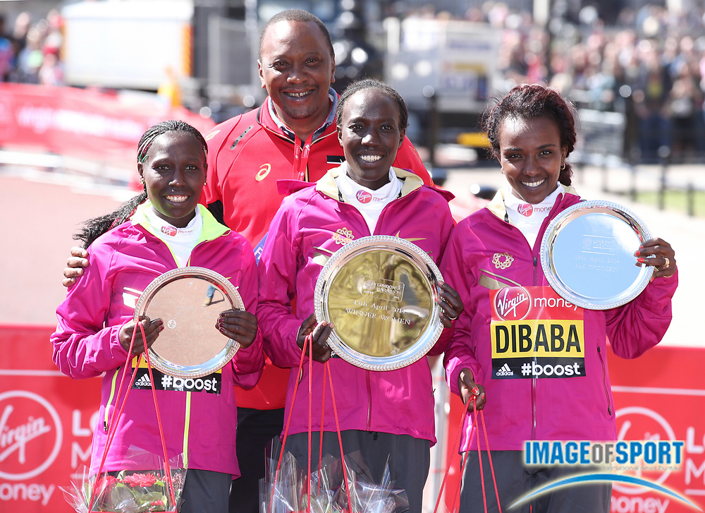 Apr 13, 2014, London, United Kingdom; Kenya president <br /> Uhuru Kenyatta poses with Florence Kiplagat (KEN), left, Edna Kiplagat (KEN), center, and Tirunesh Dibaba (ETH) after the 2014 Virgin Money London Marathon. Photo by Jiro Mochizuki