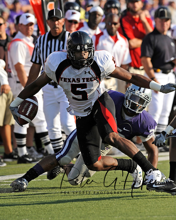 MANHATTAN, KS - OCTOBER 04:  Wide receiver Michael Crabtree #5 of the Texas Tech Red Raiders rushes up field in the first half for a first down, during a game against the Kansas State Wildcats on October 4, 2008 at Bill Snyder Family Stadium in Manhattan, Kansas.  Texas Tech won 58-28