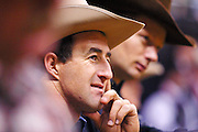 "15 DECEMBER 2002 - LAS VEGAS, NV, USA: Saddle bronc rider Scott Johnston, left, from Gustine, TX, and  bareback rider Darren Clarke watch the steer wrestling competition in the 10th round of the National Finals Rodeo in the Thomas and Mack Center in Las Vegas, NV, December 15, 2002. The NFR is the ""Super Bowl"" of rodeo. Only the top 15 cowboys from each event are invited to participate in the NFR, which runs for 10 days every December. All ten performances of the NFR sell out every year. PHOTO BY JACK KURTZ"