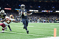 NEW ORLEANS, LA - NOVEMBER 19:  Alvin Kamara #41 of the New Orleans Saints jumps runs the ball in for a touchdown during a game against the Washington Redskins at Mercedes-Benz Superdome on November 19, 2017 in New Orleans, Louisiana.  The Saints defeated the Redskins 34-31.  (Photo by Wesley Hitt/Getty Images) *** Local Caption *** Alvin Kamara
