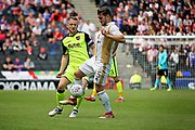 MKDons defender Jordan Moore-Taylor (15) and Exeter City midfielder Jake Taylor (25) during the EFL Sky Bet League 2 match between Milton Keynes Dons and Exeter City at stadium:mk, Milton Keynes, England on 25 August 2018.