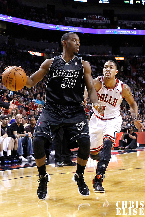 29 January 2012: Miami Heat point guard Norris Cole (30) looks to pass the ball past Chicago Bulls point guard Derrick Rose (1) during the Miami Heat 97-93 victory over the Chicago Bulls at the AmericanAirlines Arena, Miami, Florida, USA.