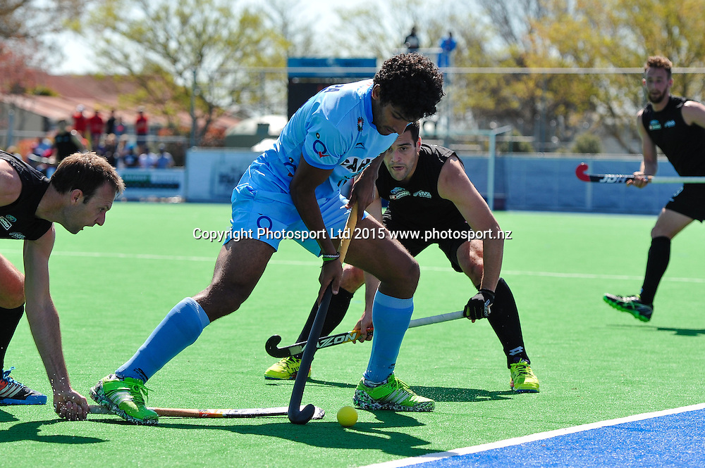 US Kushalappa of India gets surrounded  by defence during the Mens Hockey International, 2015 South Island Tour game between the New Zealand Black Sticks V India, at Marist Park, Christchurch, on the 11th October 2015. Copyright Photo: John Davidson / www.photosport.nz