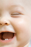 Infant child laughing with milk teeth