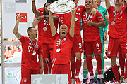 Bayern Munich's Dutch midfielder Arjen Robben, Bayern Munich's Brazilian defender Rafinha and 35 Renato SANCHES, 6 Thiago Alc&aacute;ntara, Alcantara, celebrate with he trophy  after the German First division Bundesliga football match FC Bayern Munich v Eintracht Frankfurt, <br /> MUNICH, 18. MAY 2019,  Fc BAYERN vs Eintracht FRANKFURT, 5:1 - Bundesliga Football Match, (L to R) Arjen Robben, Rafinha, Franck Ribery ,<br /> FcBayern Muenchen vs Eintracht FRANKFURT Bundesliga match at Allianz Arena on 18.05.2019, DFL REGULATIONS PROHIBIT ANY USE OF PHOTOGRAPHS AS IMAGE SEQUENCES AND/OR QUASI-VIDEO - fee liable image, <br /> copyright &copy; ATP / Arthur THILL