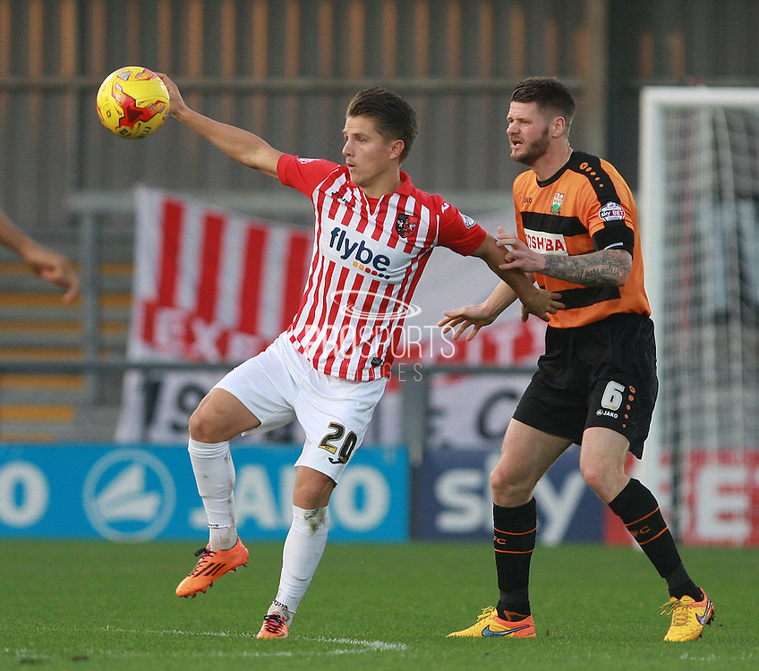 Exeter City striker Tom Nichols shields the ball from Barnet defender Michael Nelson during the Sky Bet League 2 match between Barnet and Exeter City at The Hive Stadium, London, England on 31 October 2015. Photo by Bennett Dean.
