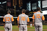 PHOENIX, AZ - AUGUST 27:  Bench coach Ron Wotus #23, third base coach Phil Nevin #16 and manager Bruce Bochy #15 of the San Francisco Giants each wearing a nickname-bearing jerseys stand for the national anthem for the game against the Arizona Diamondbacks at Chase Field on August 27, 2017 in Phoenix, Arizona.  (Photo by Jennifer Stewart/Getty Images)