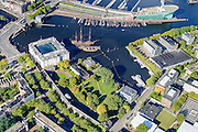 Nederland, Noord-Holland, Amsterdam, 27-09-2015; Kattenburg en Oosterdok. Overzicht Marineterrein en omgeving, linksbeneden het Scheepvaartmuseum. Verder de IJtunnel en museum Nemo.<br /> View on Navy area (center) and the National Maritime Museum (left, white building). Museum Nemo (copper green) near central station. <br /> <br /> luchtfoto (toeslag op standard tarieven);<br /> aerial photo (additional fee required);<br /> copyright foto/photo Siebe Swart