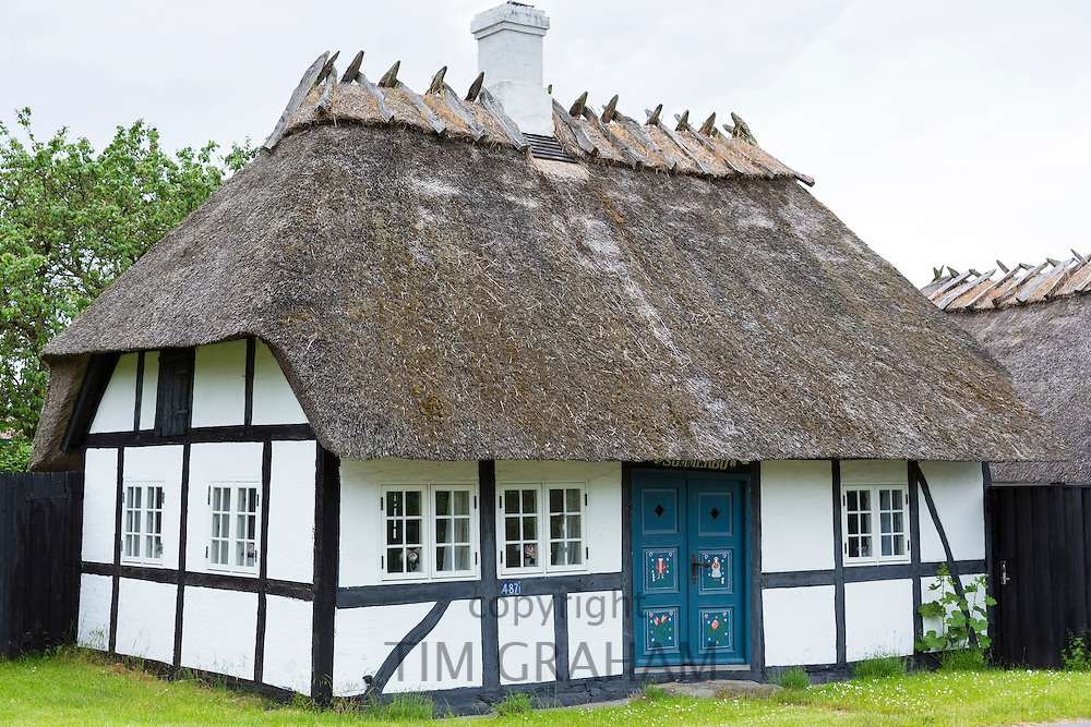 Quaint old half-timbered thatched cottage home on the island of Funen, Denmark