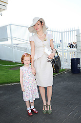 CAMILLA RUTHERFORD and her daughter MAUDE at the Investec Ladies Day at Epsom Racecourse, Surrey on 4th June 2010.