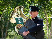 A musician from The Royal Yeomanry Band plays outside City Hall.<br /> <br /> Armed Forces Day - City Hall ceremony pays tribute to British Armed Forces, London, Great Britain 25th June 2018 <br />  <br /> The Mayor of London and the London Assembly joined members of the British Armed Forces at City Hall today for a flag-raising ceremony to honour the courage and commitment of the Armed Forces community.<br /> The annual ceremony took place ahead of National Armed Forces Day, next Saturday, and was attended by members of the Forces as well as veterans, reserves, cadets and representatives from military charities. It is the 10th Armed Forces Day ceremony organised by the Mayor and London Assembly.<br /> <br /> The Mayor, Sadiq Khan and Chair of the London Assembly, Tony Arbour AM, joined senior military figures for the ceremony, which featured musical contributions from the Band of the Royal Yeomanry.<br />  <br /> Naval Commodore David Elford OBE, Army Colonel Victor Matthews OBE and Air Commodore David Prowse OBE from the Royal Air Force offered a joint military response.<br /> The Armed Forces flag was raised by Cadet Cpl Aaron Harmsworth and Cadet Charlotte McCarthy.<br /> <br /> Photograph by Elliott Franks