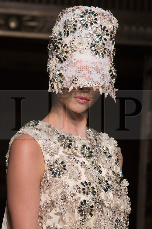 © Licensed to London News Pictures. 15 February 2014, London, England, UK. A model walks the runway at the Ashley Isham show during London Fashion Week AW14 at Fashion Scout/Freemasons' Hall. Photo credit: Bettina Strenske/LNP