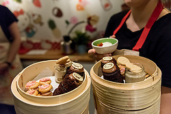 © Licensed to London News Pictures. 01/06/2016. London, UK. A pop up cafe has opened for the summer at Cutter & Squidge in Soho serving Hello Kitty's Secret Garden Afternoon Tea (served in bamboo steamer containers, pictured).  Natural, handmade products inspired by the Hello Kitty character popular worldwide, are on offer in Sanrio's first official Helly Kitty pop up cafe in Europe. Photo credit : Stephen Chung/LNP