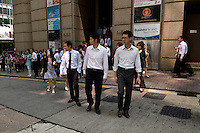 Young executives at lunch time in Central, Hong Kong.