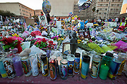 """15 JANUARY 2011 - TUCSON, AZ: The memorial on the lawn in front of the University Medical Center in Tucson, AZ, Saturday, January 15. The memorial has been growing since the mass shooting last week. Six people were killed and 14 injured in the shooting spree at a """"Congress on Your Corner"""" event hosted by Congresswoman Gabrielle Giffords at a Safeway grocery store in north Tucson on January 8. Congresswoman Giffords, the intended target of the attack, was shot in the head and seriously injured in the attack. She is hospitalized at UMC. The alleged gunman, Jared Lee Loughner, was wrestled to the ground by bystanders when he stopped shooting to reload the Glock 19 semi-automatic pistol. Loughner is currently in federal custody at a medium security prison near Phoenix.  Photo by Jack Kurtz"""