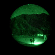 Night-vision goggle view of Forward Operating Base Bostick, Kunar Province of Eastern Afghanistan.