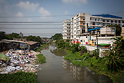 Environmental pollution on the river banks surrounding some of the textile industry buildings of Savar Upazila, a district of Dhaka, Bangladesh.  30th September 2018. The garment business is the main industry of Savar Upazila, a district in the northern part of Dhaka.  (photo by Andrew Aitchison / In pictures via Getty Images)