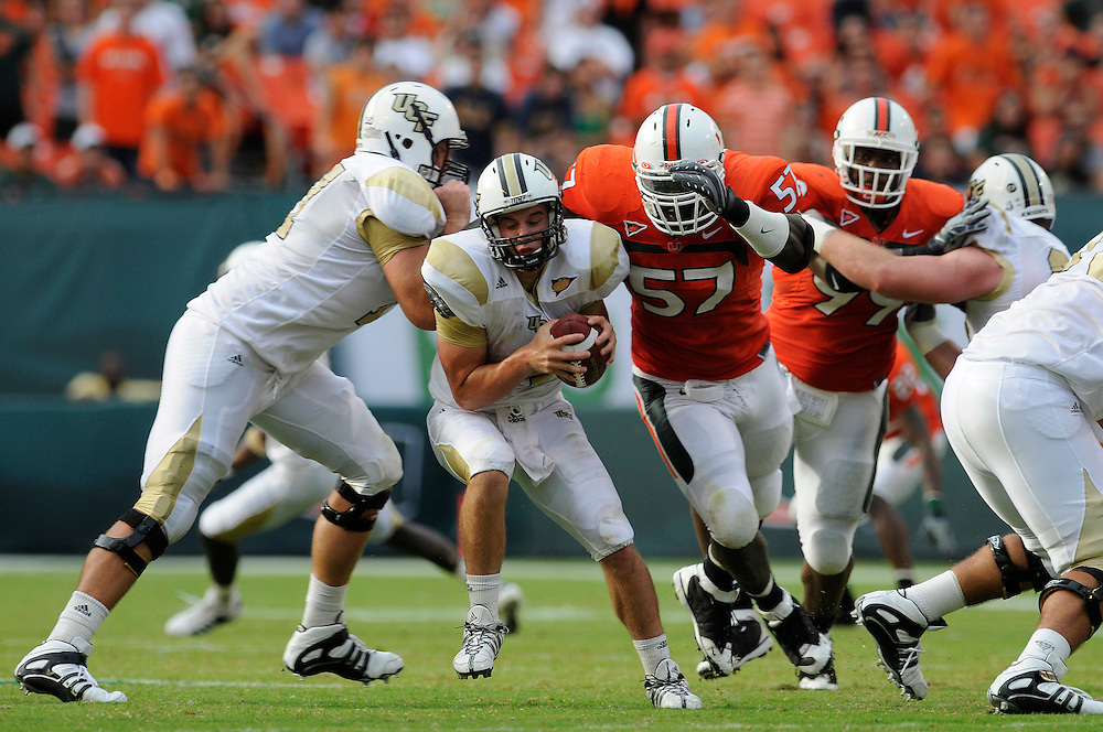 October 11, 2008 - Miami Gardens, FL<br /> <br /> University of Central Florida quarterback Rob Calabrese is sacked by University of Miami defensive lineman Allen Bailey during the Hurricanes 20-14 victory over the Knights at Dolphin Stadium in Miami Gardens, Florida.<br /> <br /> JC Ridley/CSM