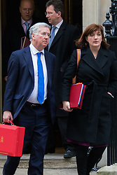 London, February 10th 2015. Ministers arrive at the weekly cabinet meeting at 10 Downing Street. PICTURED: Dence Secretary Michael Fallon leaves with Education Secretary Nicky Morgan.
