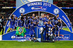 Chelsea Manager Jose Mourinho jumps on the floor as his side  celebrate with the trophy after winning the Capital One Cup Final - Photo mandatory by-line: Rogan Thomson/JMP - 07966 386802 - 01/03/2015 - SPORT - FOOTBALL - London, England - Wembley Stadium - Chelsea v Tottenham Hotspur - Capital One Cup Final.