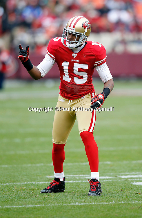 San Francisco 49ers wide receiver Michael Crabtree (15) motions with his hand as he gets set to go out for a pass during the NFL week 17 football game against the Arizona Cardinals on Sunday, January 2, 2011 in San Francisco, California. The 49ers won the game 38-7. (©Paul Anthony Spinelli)