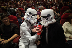 © Licensed to London News Pictures . 16/12/2015 . Manchester , UK . Two storm troopers pose with drinks in the cinema . Star Wars fans attend the midnight screening of Star Wars the Force Awakens at the AMC Great Northern cinema in Manchester City Centre . Photo credit : Joel Goodman/LNP