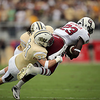 South Carolina Gamecocks wide receiver Bruce Ellington (23) gets tackled by UCF Knights defensive back Clayton Geathers (26) and UCF Knights defensive back Sean Maag (31) during an NCAA football game between the South Carolina Gamecocks and the Central Florida Knights at Bright House Networks Stadium on Saturday, September 28, 2013 in Orlando, Florida. (AP Photo/Alex Menendez)