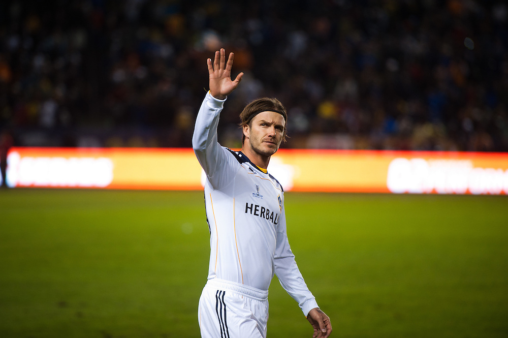 David Beckham of the LA Galaxy looks into the audience and waves to someone before the MLS Cup at the Home Depot Center in Los Angeles, Calif., on November 20, 2011. Los Angeles Galaxy defeated Huston Dynamos 1-0 in the Championship game...©Benjamin B Morris