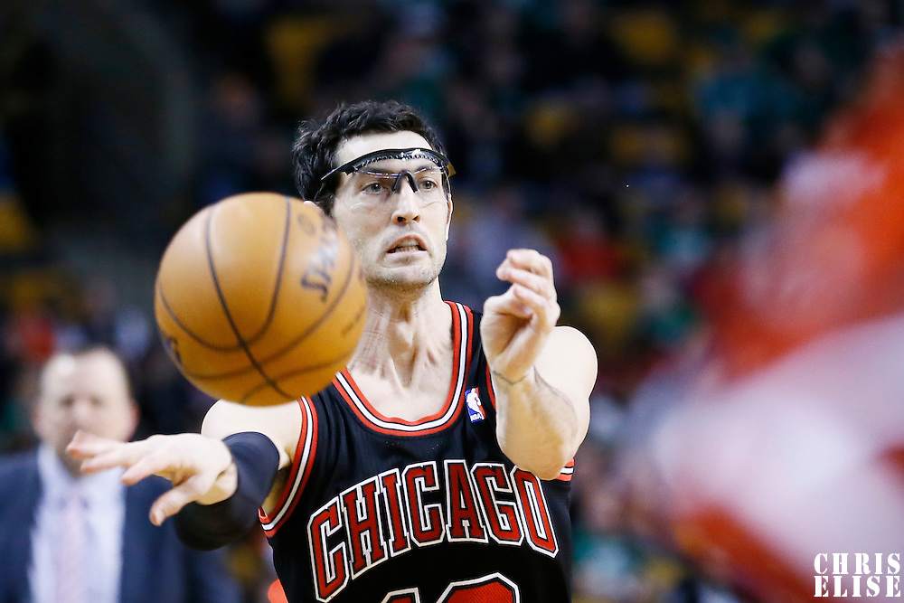 18 January 2013: Chicago Bulls shooting guard Kirk Hinrich (12) passes the ball during the Chicago Bulls 100-99 overtime victory over the Boston Celtics at the TD Garden, Boston, Massachusetts, USA.