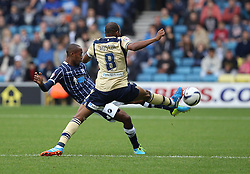 Leeds United's Rodolph Austin vies for possession with Millwall's Nadjim Abdou - Photo mandatory by-line: Robin White/JMP - Tel: Mobile: 07966 386802 28/09/2013 - SPORT - FOOTBALL - The Den - Millwall - Millwall V Leeds United - Sky Bet Championship