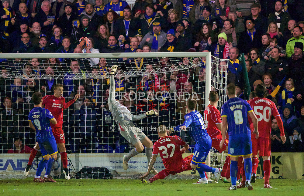 KINGSTON-UPON-THAMES, ENGLAND - Monday, January 5, 2015: AFC Wimbledon's Sean Rigg shoots over the Liverpool bar during the FA Cup 3rd Round match at the Kingsmeadow Stadium. (Pic by David Rawcliffe/Propaganda)