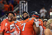 Clemson Tigers safety Isaiah Simmons (11) and defensive end Austin Bryant (7) celebrate a big win over the Notre Dame Fighting Irish in the NCAA Cotton Bowl semi-final playoff football game, Saturday, Dec. 29, 2018, in Arlington, Texas. Clemson defeated Notre Dame 30-3 to advance to the College Football Playoff national Championship. (Mario Terana/Image of Sport)