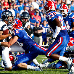 December 4, 2010; Ruston, LA, USA; Louisiana Tech Bulldogs linebacker Dusty Rust (48) tackles Nevada Wolf Pack quarterback Colin Kaepernick (10) during the first half at Joe Aillet Stadium.  Mandatory Credit: Derick E. Hingle